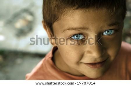 Fine art portrait of cute kid with blue eyes - stock photo