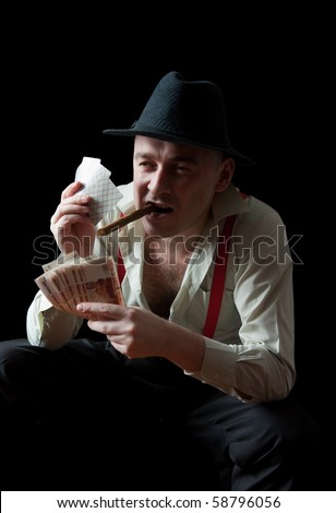 Fine art portrait of man smoking a cigar with money