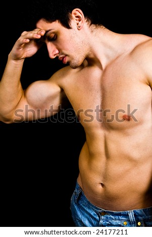 Fine art portrait of muscular sexy bodybuilder - stock photo