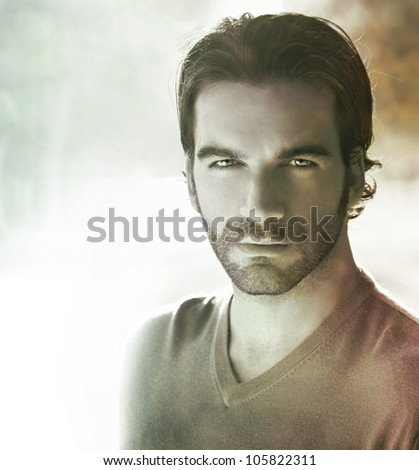 Fine art stylized classic portrait of a handsome man with vintage toning