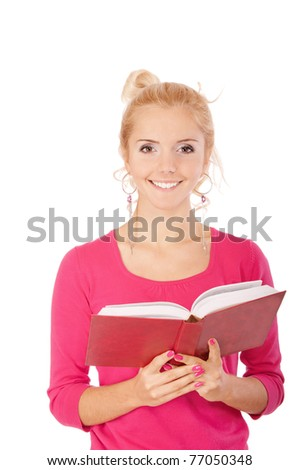 Fine blonde in red blouse reads book and laughs, isolated on white background. - stock photo