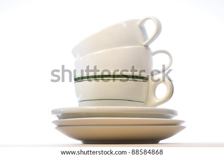 Fine bone China Coffee Cups on wood veneer - stock photo