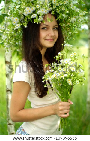Fine brunette with a sweet expression on her face in the countryside - stock photo