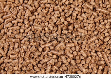 fine closeup image of natural wood pellet on white - stock photo