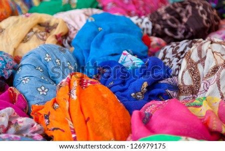 Fine colored fabrics offered at market stall
