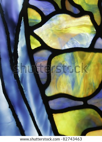 Fine detail of stained glass window - stock photo