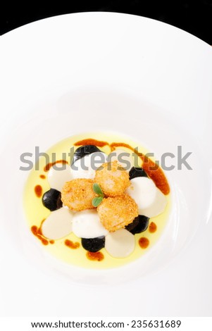 Fine dining, deep fried scallops  with olive oil, cheese and balsamic vinegar - stock photo