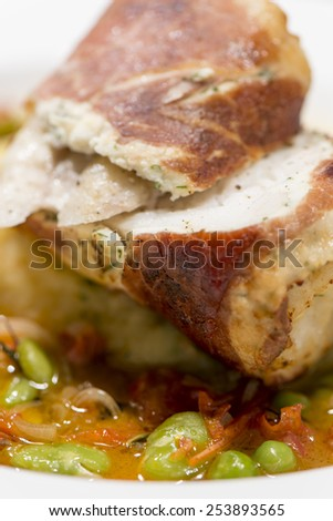 Fine Dining - Monkfish Wrapped In Parma Ham With Mashed Potatoes, Chorizo And Thyme Broth / Fish - Monkfish With Vegetables - stock photo