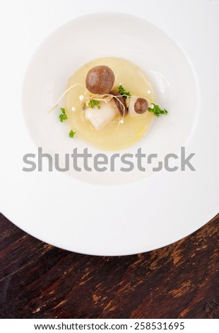 Fine dining, mushroom Porcini soup in a gourmet restaurant - stock photo
