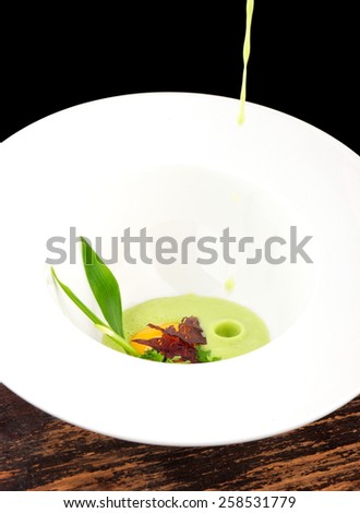 Fine dining, Poached Egg with spinach sauce and Truffel Slice - stock photo