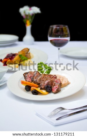Fine dining restaurants are full service restaurants with specific dedicated meal courses - stock photo
