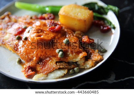 Fine dining Seabass fillets with tomato and spices sauce