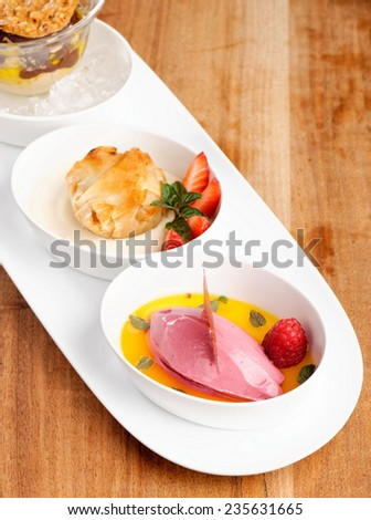 Fine dining, strudel with ice cream and berries dessert on restaurant table, shallow focus depth  - stock photo
