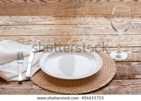 Fine empty  tableware on a wooden table is ready for tasting delicious. Top view on table laying - stock photo
