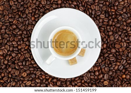 fine espresso in cup on coffee beans, coffee theme - stock photo