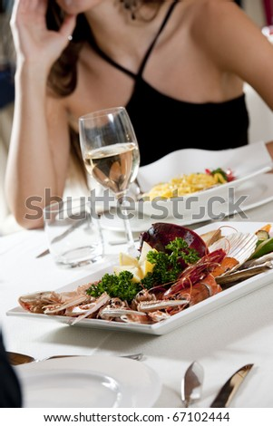 Fine fish dinner, unrecognizable people - stock photo