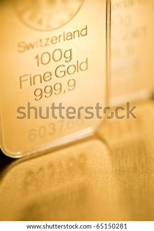 fine gold ingot  background. closeup. - stock photo