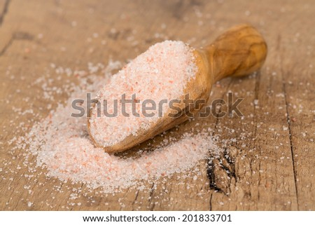 fine himalayan salt in a wooden scoop - stock photo