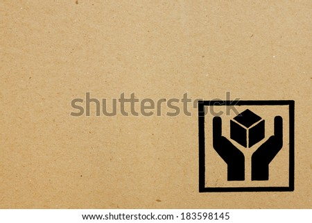 Fine image close-up of fragile symbol on cardboard. - stock photo