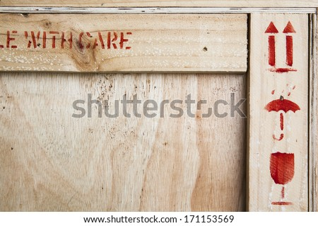 Fine image close-up of fragile symbol on wood board. - stock photo