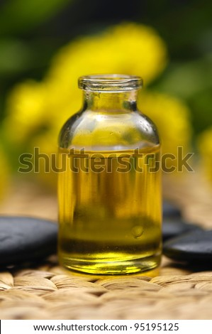 fine image of massage oil with zen stones, spa background