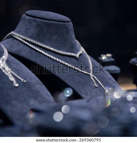 Fine luxury diamond jewellery window display with necklace carcanet chaplat choker pedant - stock photo