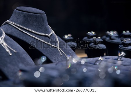 Fine luxury diamond jewellery window display with necklace carcanet chaplat choker pedant - whatta women want - stock photo