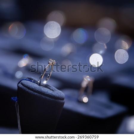 Fine luxury diamond jewellery window display with ring  pedant - whatta women want - stock photo