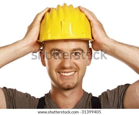 fine portrait of caucasian smiling handyman isolated on white