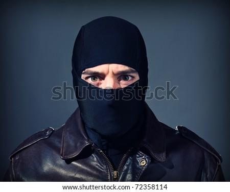fine portrait of white thief with black balaclava
