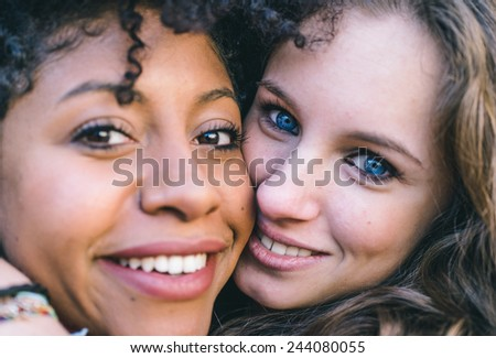 fine portrait with two girls of different ethnicity - stock photo