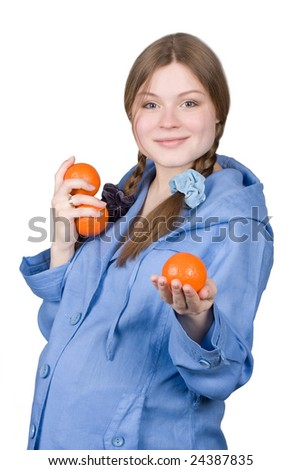 fine pregnant woman in blue holding three orange on white background - stock photo