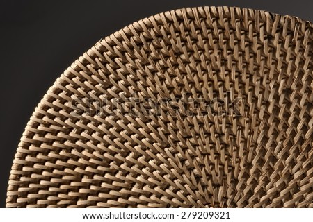 Fine quality wicker,in various sensitive lights.Dark gray background.Landscape format.