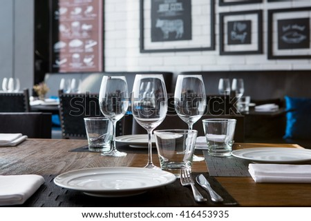 Fine restaurant dinner table place setting - stock photo