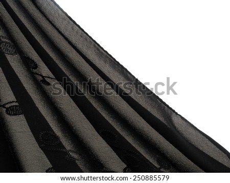Fine, shades of grey, gray fabric in folds. Revealing white background. With embroidery detail on material.