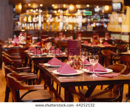 Fine table setting in gourmet restaurant - stock photo