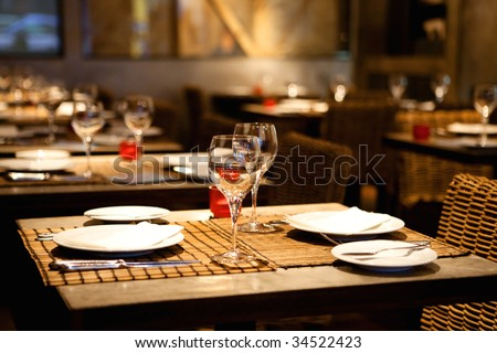 Fine table setting in gourmet restaurant (close-up, shallow dof) - stock photo