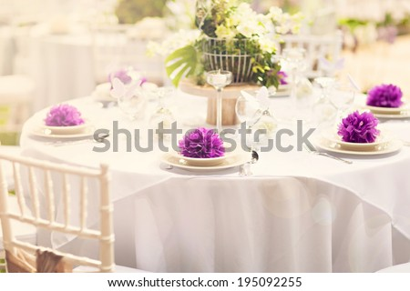 Fine table setting in gourmet restaurant, wedding decoration table, (close-up, shallow dof, bright image)  - stock photo