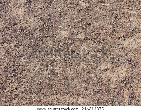fine texture of brown gravel on a dirt road - stock photo