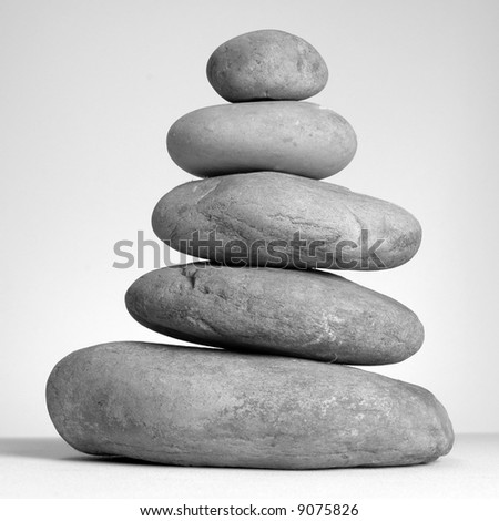 Finely balanced tower of natural stones. - stock photo