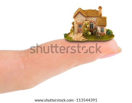 Finger and house isolated on white background - stock photo