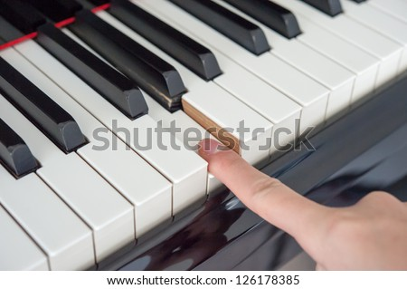 finger and piano - stock photo