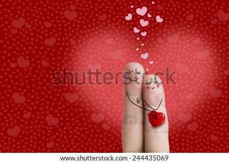 Finger art. A happy couple in love painted, smiley and hugging. Lovers is embracing and holding red heart. Valentines Day, wedding, birthday and 8 March creative love series. There is path in image.  - stock photo