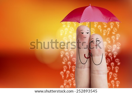 Finger art. couple of lovers is embracing and holding red umbrella. Stock Image Happy Valentine's Day, wedding and 8 March creative love series. Painted fingers in love - stock photo