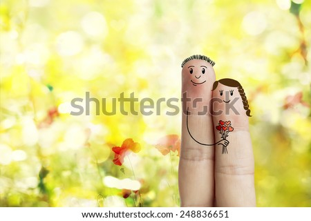 Finger art. Lovers is embracing and holding bouquet Happy Valentine's Day and 8 March love theme series. Painted fingers Stock Image. Spring yellow meadow  - stock photo