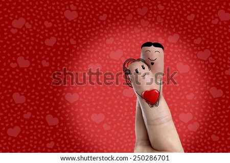 Finger art. Lovers is embracing and holding red heart. Stock Image Happy Valentine's Day and 8 March creative love series. Painted fingers in love  - stock photo