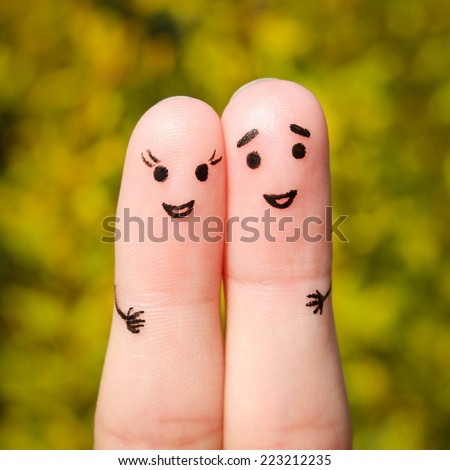 Finger art of a Happy couple. A man and a woman hug on the background of yellow leaves - stock photo