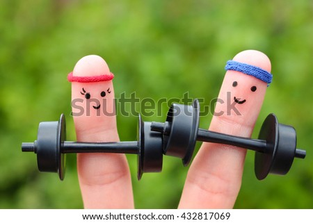 Finger art of a Happy couple. Concept of men and women in sports - stock photo