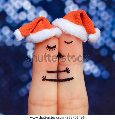 Finger art of a Happy couple. Couple kissing and hugging in the new year hats.  - stock photo