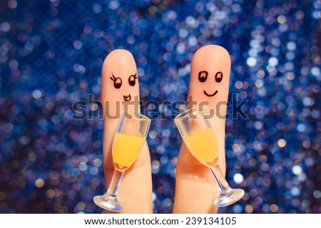 Finger art of a Happy couple. Couple making good cheer. Two glasses of champagne. Toned image.  - stock photo